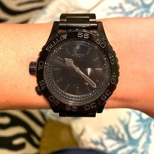 Nixon Women's all black watch with crystals